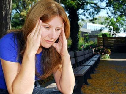 Woman with migraine headache