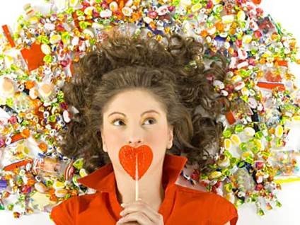 Heart lollipop and woman with candy surrounding her head