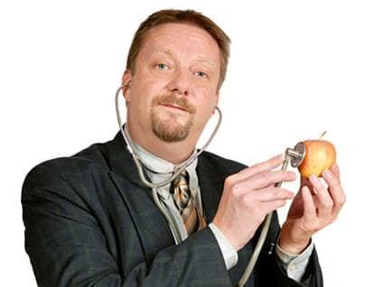 Man takes stethoscope to apple