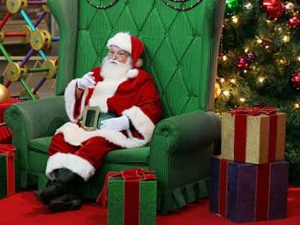 Santa Claus sitting in a chair