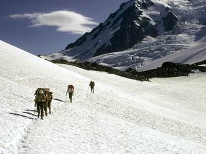 Hikers on a snowy mountain