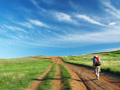 Man hiking on a dirt road