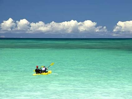 Yellow kayak out to sea