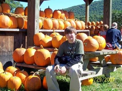 Teenager In Pumpkin Patch