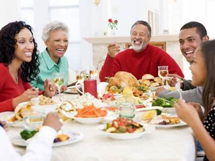 Celebrate Kwanzaa African-American family dinner table
