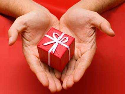 Hands holding a red present
