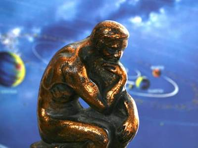 Thinker statue and solar system