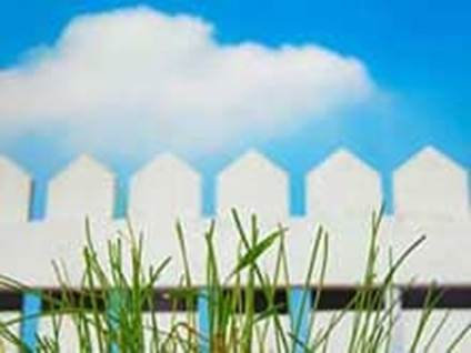 white picket fence on blue sky