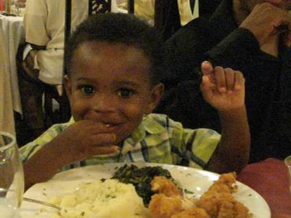 Cute black boy eating