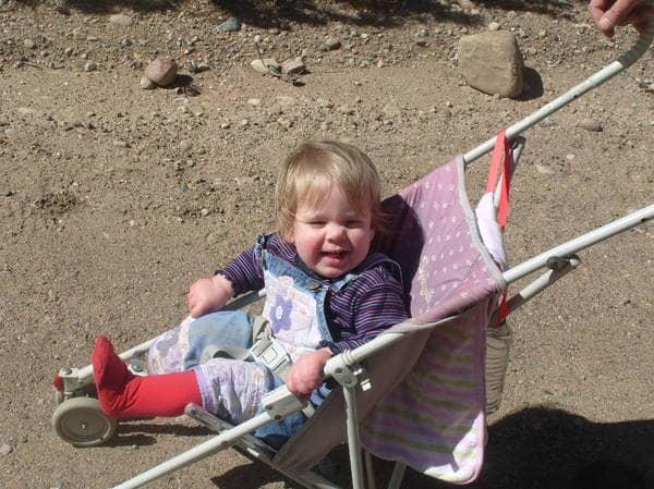 Cute blone child in a stroller