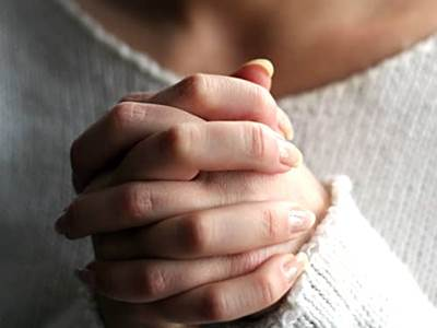 Woman praying hands