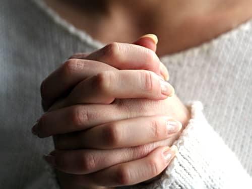 Woman praying hands