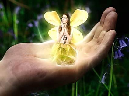 Hand holding golden fairy