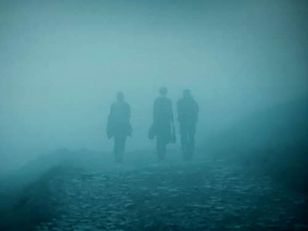 People walking in fog and mist