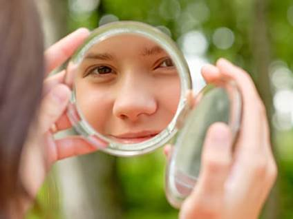 Woman's reflection in a mirror
