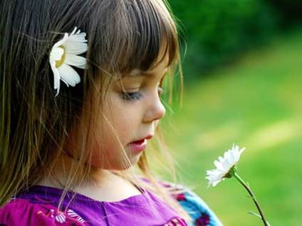 Little girl with flower
