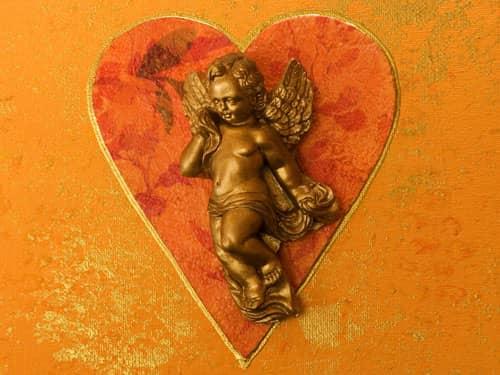 Gold cherub on red heart