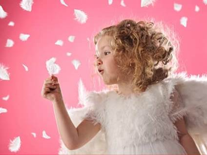 Little angel girl with feathers