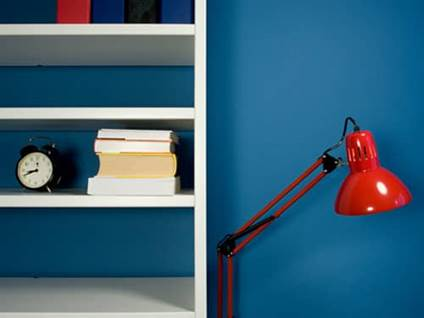 White bookshelf Blue Wall Red Lamp