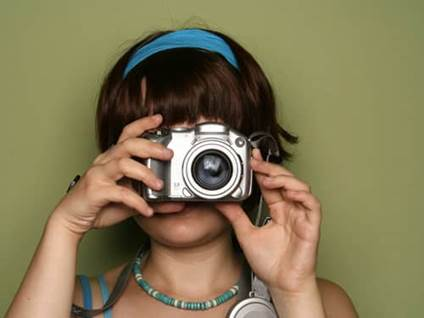 Young woman taking a photo digital camera