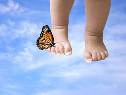 Baby feet with butterfly