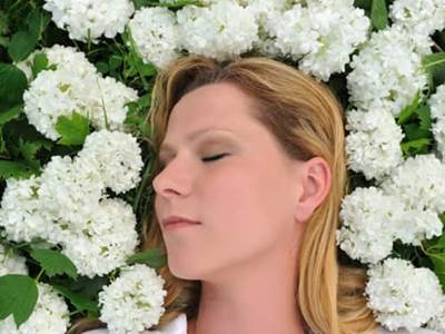 Woman in Bed of Flowers
