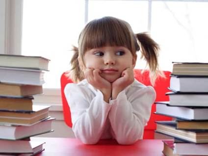 Cute kid with Books