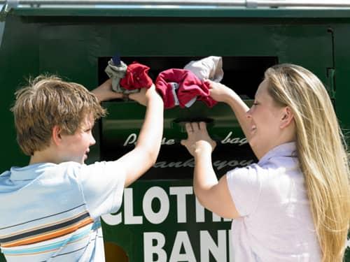 Family donating clothing