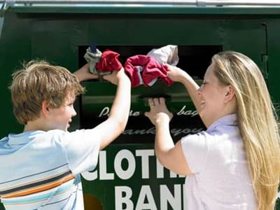 Family donating clothing
