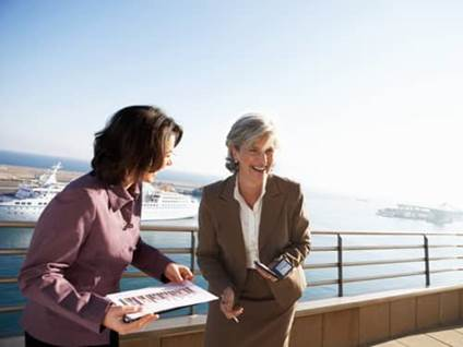 Two businesswomen on pier