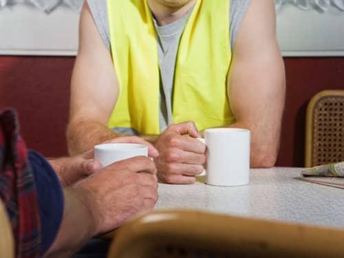Two men drinking coffee