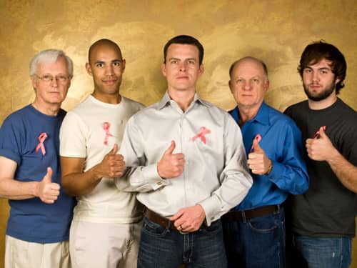 Group of men supporting breast cancer awareness