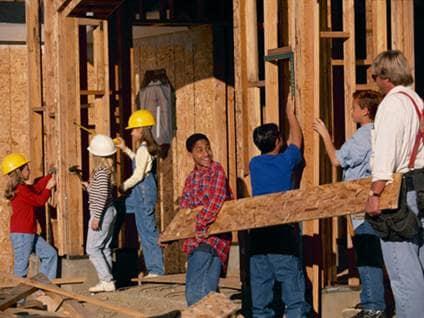 Children building a house