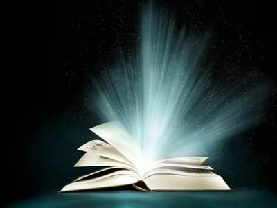 light bursting from an open book