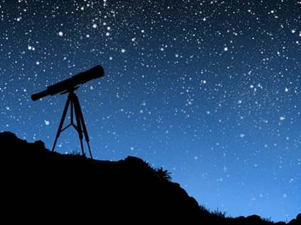 telescope against a starry night