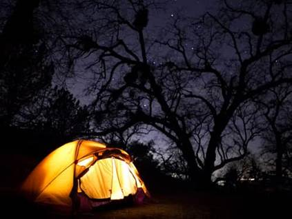 glowing camp tent at night
