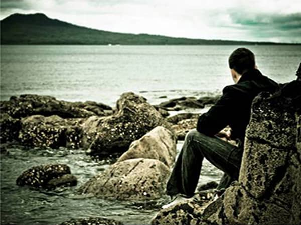 Person sitting on beach
