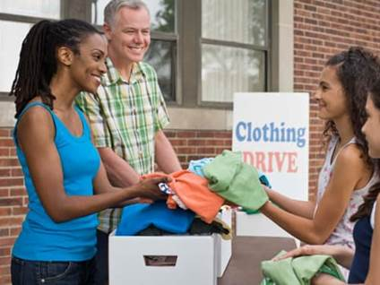 people volunteering at clothing drive
