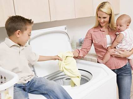 Teaching Responsibility, boy learning to do laundry