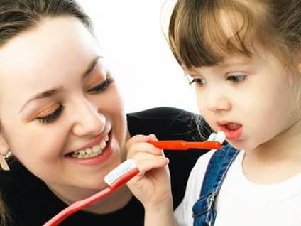 Teaching Responsibility, self-care skills, girl brushing teeth