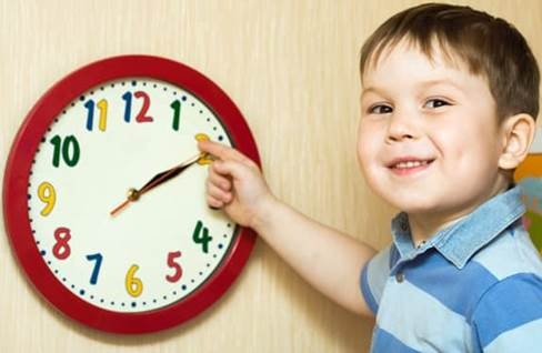 teaching patience - boy learning to tell time