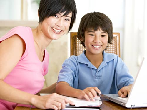 Teaching respect - mom and son on computer