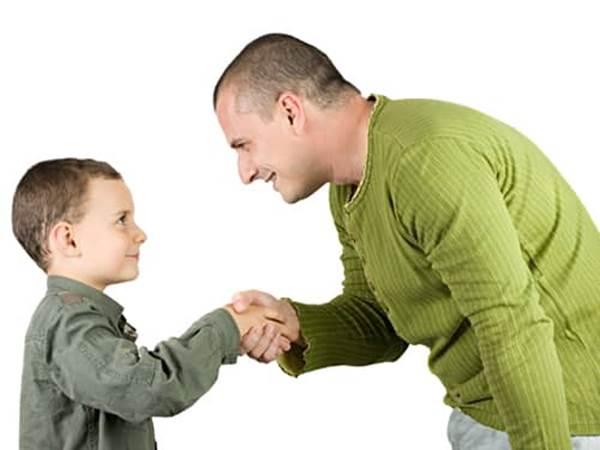 Be a role model of respect - dad teaches son to shake hands