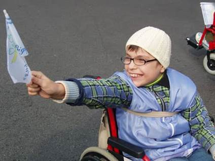 child with disability at special event