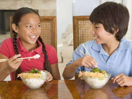 kids sharing Chinese food