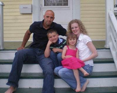 Courtney, husband John, and her two stepchildren