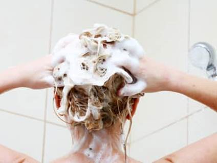 Woman Shampoo Hair in Shower