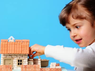 little girl building home