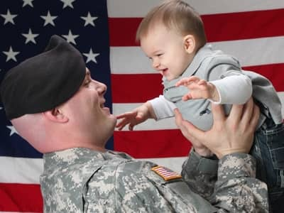 soldier dad holding baby