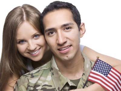 military couple with usa flag